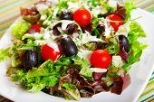 image of black-cherry  - Fresh salad with cherry tomatos black olives and mayonnaise dressing - JPG