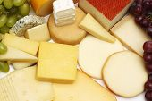 stock photo of brie cheese  - Cheese assortment Pile of different gourmet cheese - JPG