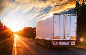 foto of semi trailer  - White truck on the asphalt road in the evening - JPG