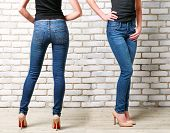 picture of skinny  - Slim Woman Wearing Blue Skinny Jeans - JPG