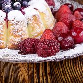 image of cheesecake  - cheesecake  with some fruits on wooden background - JPG