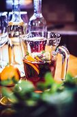 image of sangria  - Large jar of sangria with red wine, oranges and ice for home party, home kitchen interior. Homemade food and drinks