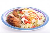 picture of thighs  - Colorful salad with chicken thigh and wing on the side - JPG