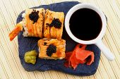 pic of soy sauce  - Arrangement of Maki Sushi with Salmon Crab Shrimp and Black Caviar on with Soy Sauce Ginger and Wasabi on Black Stone Plate - JPG
