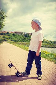 picture of skateboard  - Sporty child with his skateboard outdoor - JPG