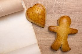 image of gingerbread man  - Gingerbread man with heart and vintage parchment for placing text - JPG
