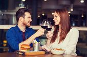 leisure, celebration, food and drinks, people and holidays concept - smiling couple having dinner an poster