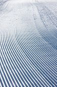 Snow pattern made by snowplow on a ski slope