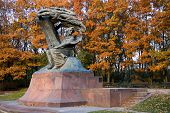 Fall in Lazienki park with monument of Chopin. Warsaw, Poland.