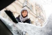 stock photo of ice-scraper  - person removing snow and ice from window - JPG