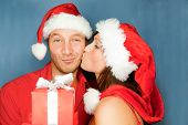 Lovely christmas couple holding presents