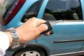 stock photo of car key  - details of man handle electronic car key - JPG