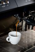 making a cup of coffee using espresso