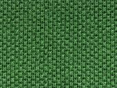 green polo shirt fabric knit texture. high magnification. perpendicular knit line.
