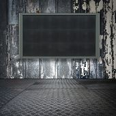 Grungy steel room with wide screen monitor