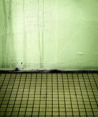Grungy tiled room with water streaks