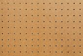 stock photo of pegboard  - Peg board texture close up and square to screen dimension - JPG