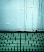 blue tiled room with water streaks.