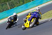 HUNGARORING, HUNGARY - JUNE 19:  Unidentified riders negotiate a corner during ROSBK event at Hungar