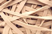 Heap of rubber bands, close-up poster