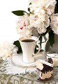 chocolate cake with whipped cream and a cup of coffee
