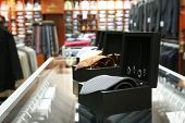 pic of coat tie  - Male neck ties in a modern fashion store - JPG