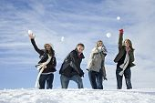 stock photo of chums  - Snowball fight - JPG