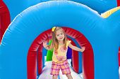 stock photo of inflatable slide  - Child playing on Inflatable Playground - JPG