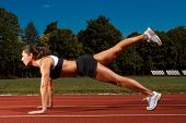 Athletic woman working out on track
