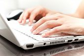 stock photo of web surfing  - Writing on a white laptot - JPG