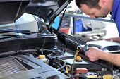 picture of car repair shop  - Car mechanic changing oil  - JPG