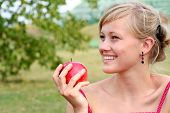 Young Woman Holding Apple