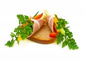 Ham Roll With Vegetables And Parsley On A Piece Of Bread.