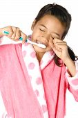Young Girl Brushing Her Teeth In The Morning