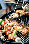 image of barbecue grill  - Sizzling chicken and sausages with lamb kebabs and vegetables on hot barbecue grill - JPG