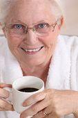 Portrait of an elderly woman drinking coffee
