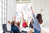 Candid Group Of Young Creative Team Employee Prople Throwing Documents Paper And Feeling Happy After poster
