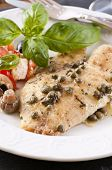 stock photo of pangasius  - Fish piccata with salad - JPG