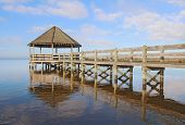 Gazebo, Dock, Blue Sky And Clouds Over Calm Sound Waters