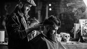 Barber With Clipper Trimming Hair On Nape Of Client. Barber With Hair Clipper Works On Haircut Of Be poster