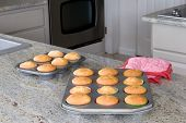 cupcakes in baking pans on kitchen countertop