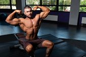 Bodybuilder Performing Rear Double Biceps Pose poster