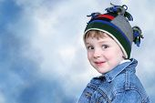 Adorable Four Year Old Boy In Winter Hat poster