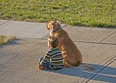 Little Boy Sitting With His Dog