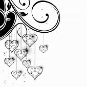 Vector illustration of hanging heart shapes in black and white color with decorative floral work for Valentines Day and other occasions.