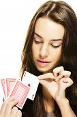 beautiful woman picks a poker card