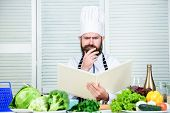 Ultimate Cooking Guide Step By Step. Book Recipes Copy Space. Man Chef In Hat And Apron Read Book. C poster