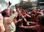 DELHI, INDIA - MARCH 08: People covered in paint on Holi festival, March 08, 2012, Delhi, India. Hol