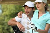 image of ball cap  - Couple playing golf - JPG