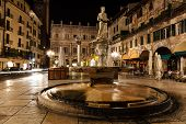 Statue Of The Madonna On Piazza Delle Erbe At Night, Verona, Veneto, Italy